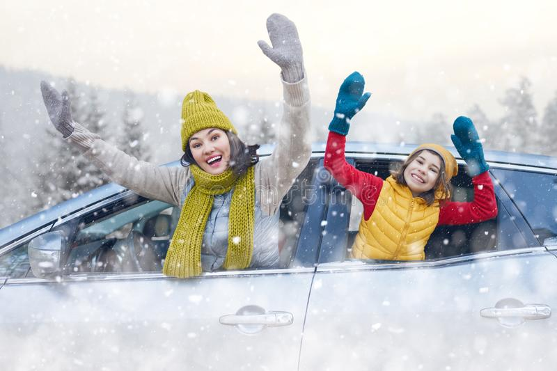 Mother, child and car on snowy winter nature stock images