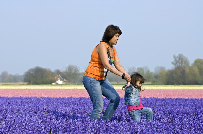 Mother and child in colorful bulb field. Netherlands, North Holland province, village Heiloo. One of the attractions of the bulb area, Kennemerland, head of royalty free stock images