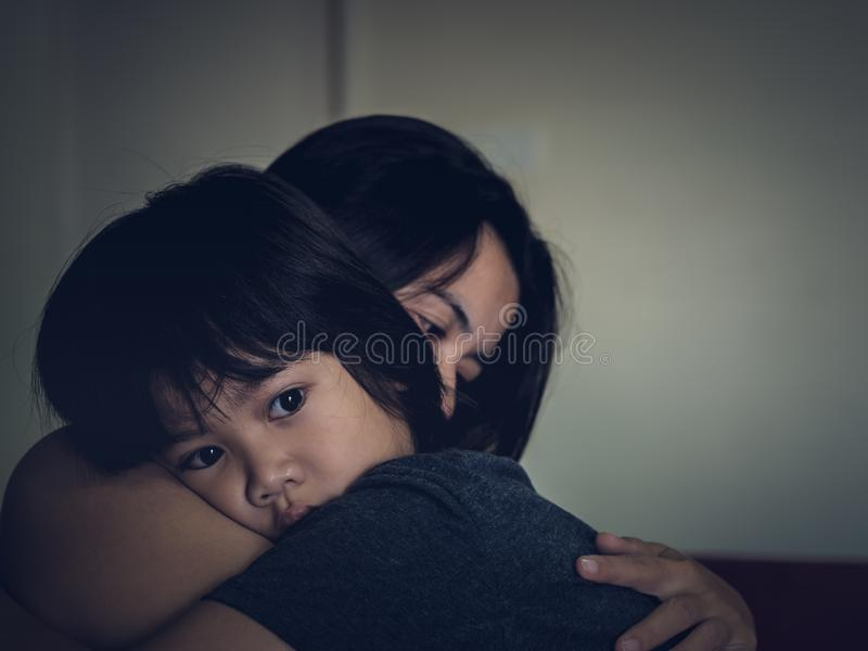Young mother holding her sad boy at home. stock images