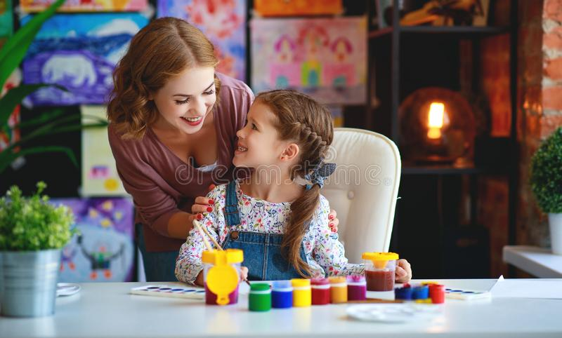 Mother and child daughter painting draws in creativity in kindergarten royalty free stock photography
