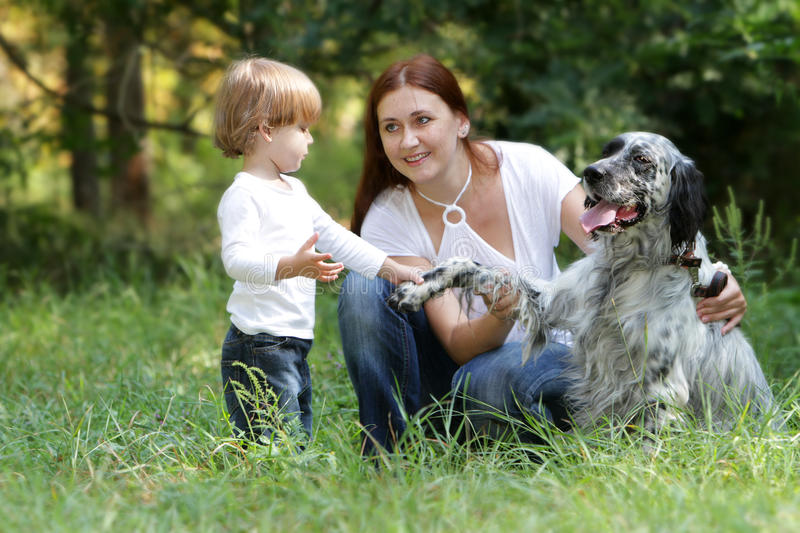 Mother and child with dog outdoors royalty free stock images