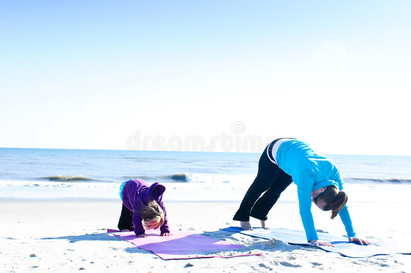 Mother And Child Doing Yoga Stock Photography