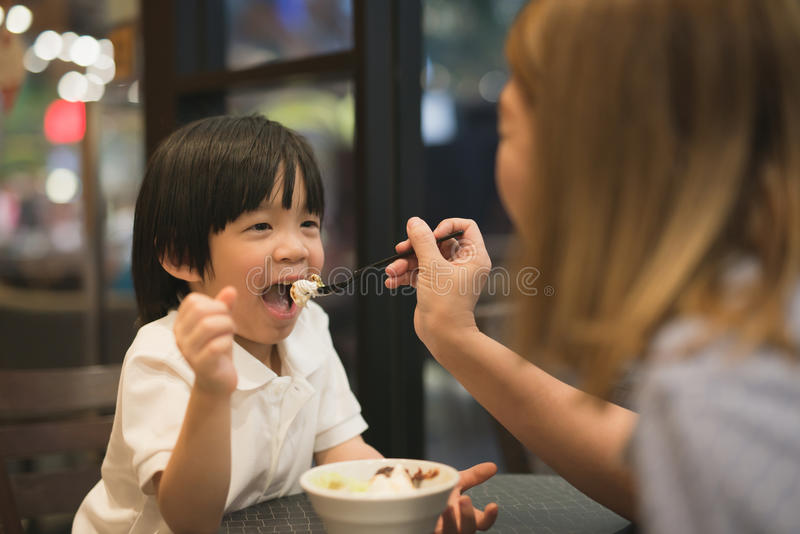 Mother and child eating ice cream stock photo