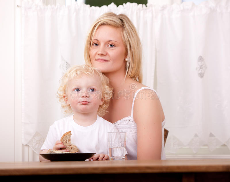 Mother and Child Eating Meal stock photos