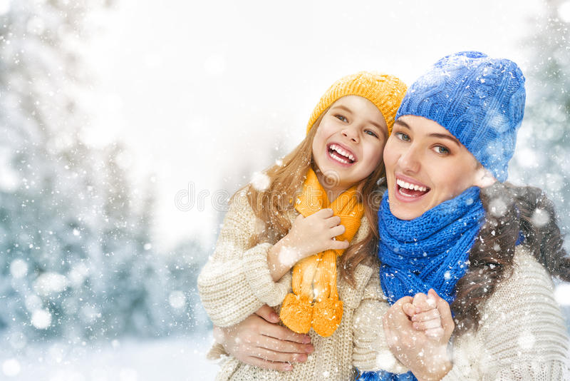 Mother and child girl on a winter walk stock photography