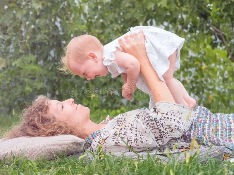 Motherly background. Mother with child. Maternity concept. Parental, natural idea. Baby girl spending time with mother. Woman`s royalty free stock photo