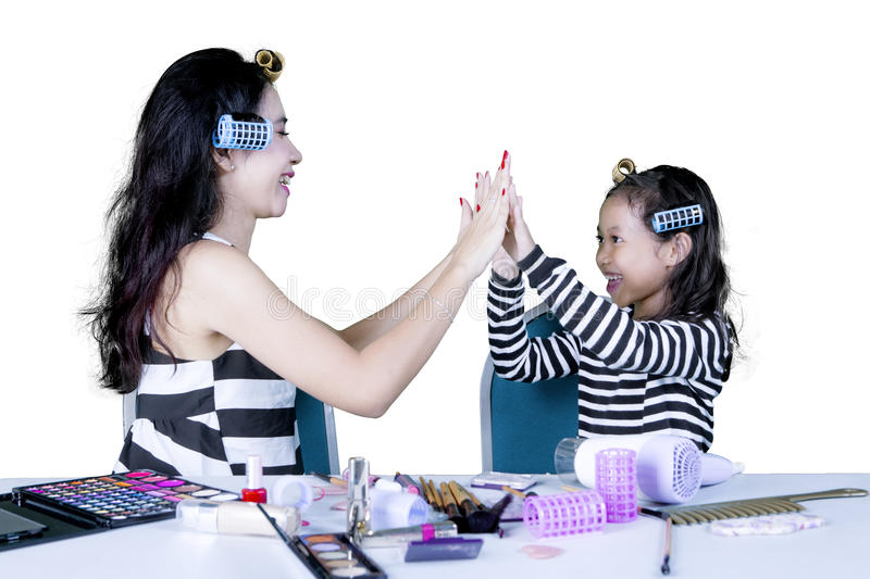 Mother and child make high five hand gesture stock images