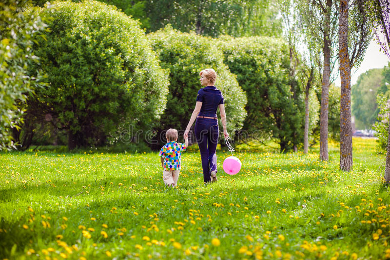 Mother and child in nature. With balloon royalty free stock images