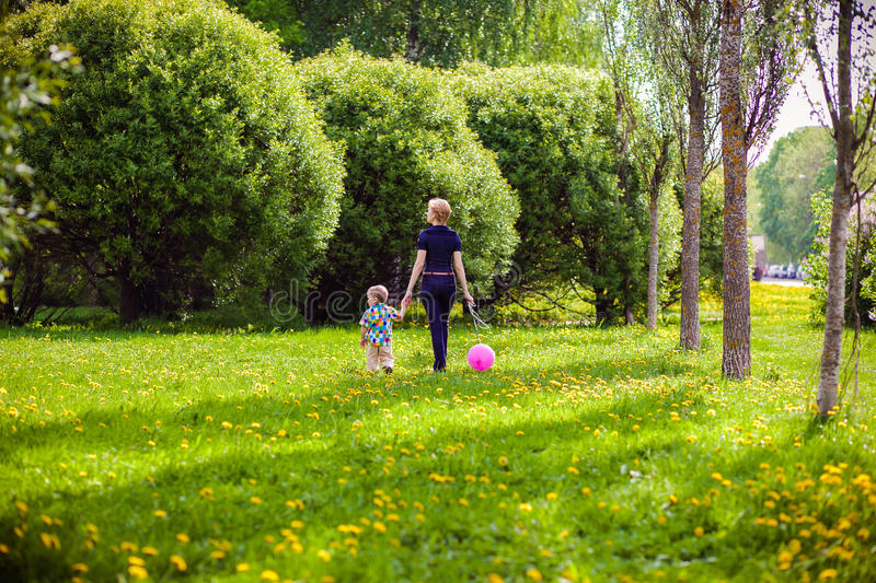 Mother and child in nature. With balloon stock image