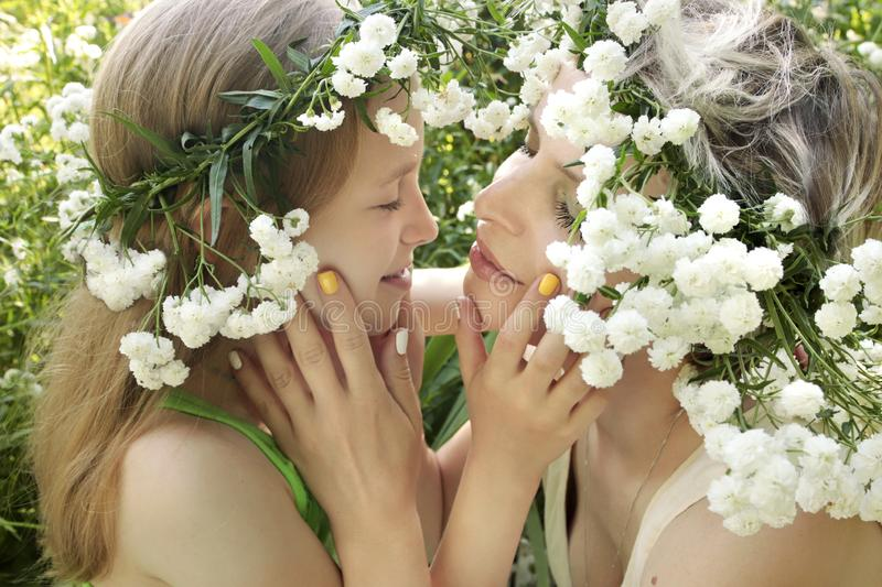 Mother and child are in nature in the summer. Flower manicure with my mother and daughter.Nail art.Mother and child are in nature in the summer in the flower of stock photography