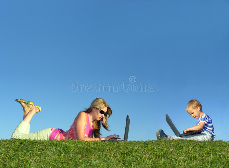 Mother with child with notebooks on grass collage stock image
