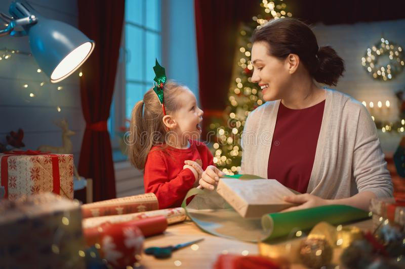 Mother and child packing gifts royalty free stock photos