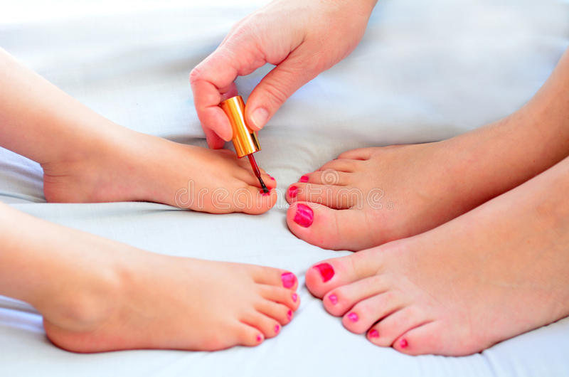 Mother And Child Paint Their Feet With Nail Polish Stock Image ...