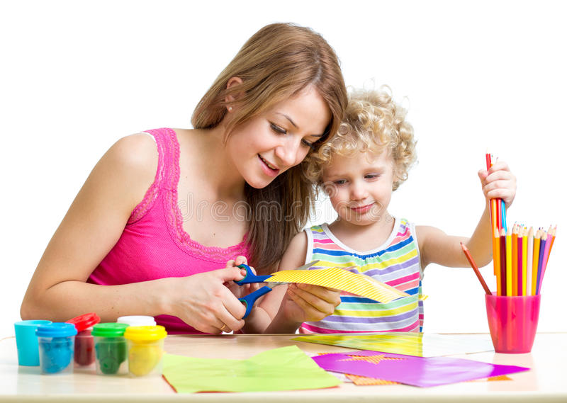 Mother and child painting and cutting royalty free stock photography