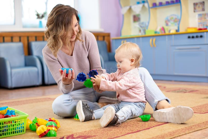 Mother and child play mosaic toy together indoors royalty free stock photos