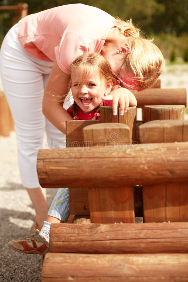 Mother and child playing royalty free stock photography
