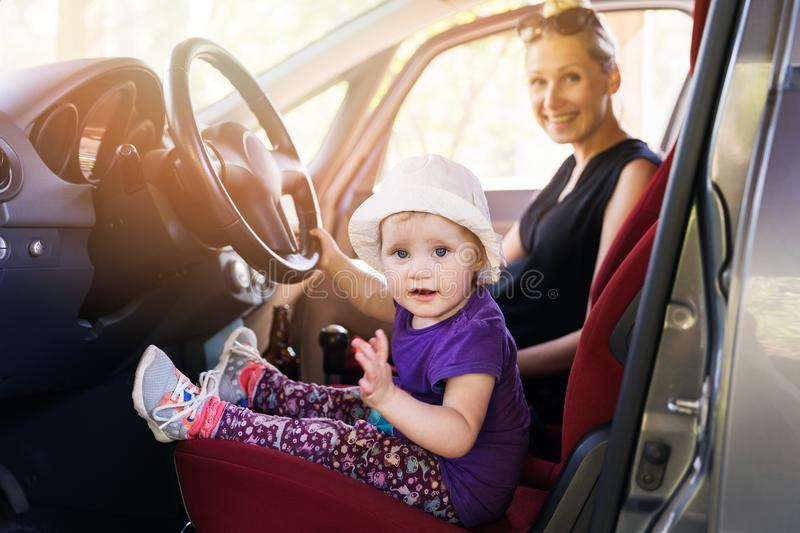 Mother with child playing in the car royalty free stock photos