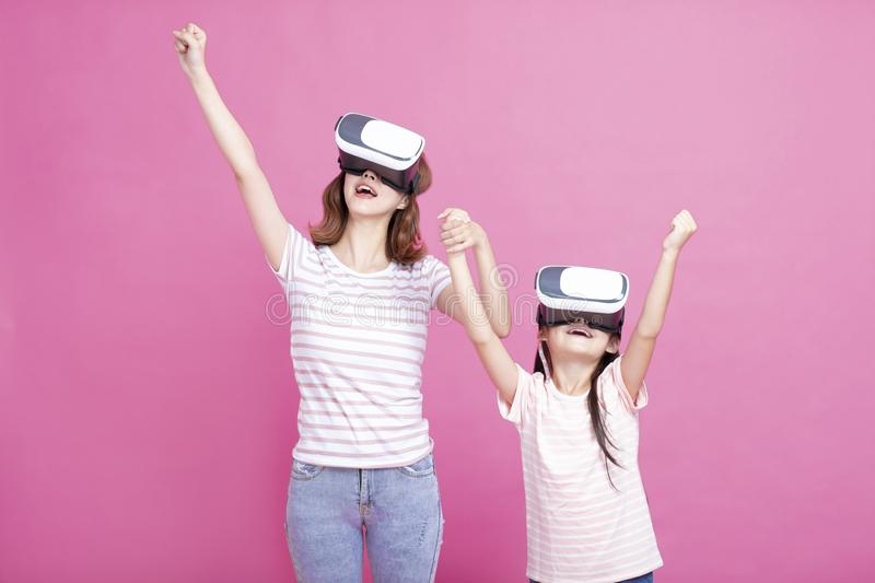 Mother and child playing together with virtual reality headsets. Happy Mother and child playing together with virtual reality headsets stock images