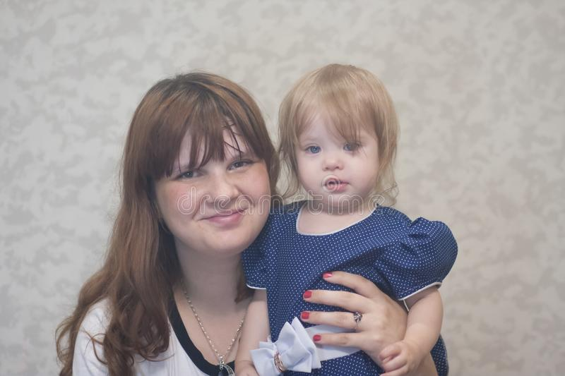 Mother and child. portrait. little. Girl with blue eyes and her mom royalty free stock images