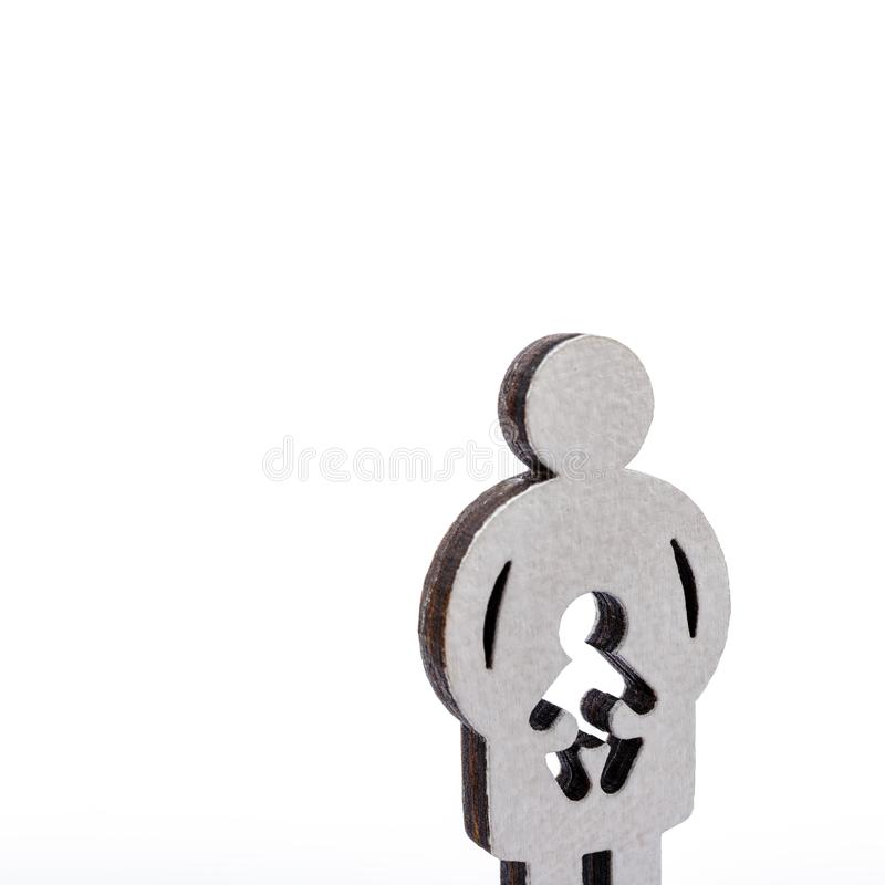 Mother and child. Pregnancy. Mother and child. Wooden figures isolated on white background. Pregnancy, abortion or adoption concept stock photography