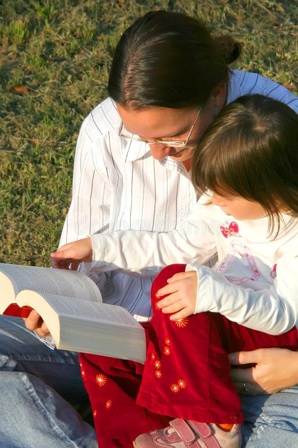 Mother and child reading royalty free stock photography