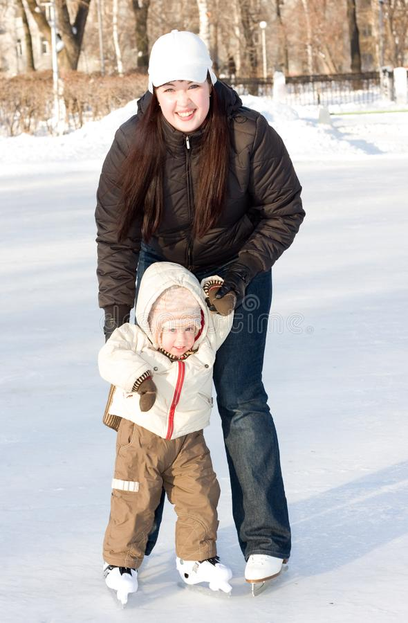 Mother and child on the rink royalty free stock photos