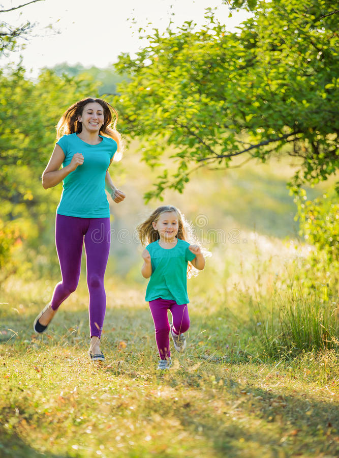 Mother with child running. In the park stock image