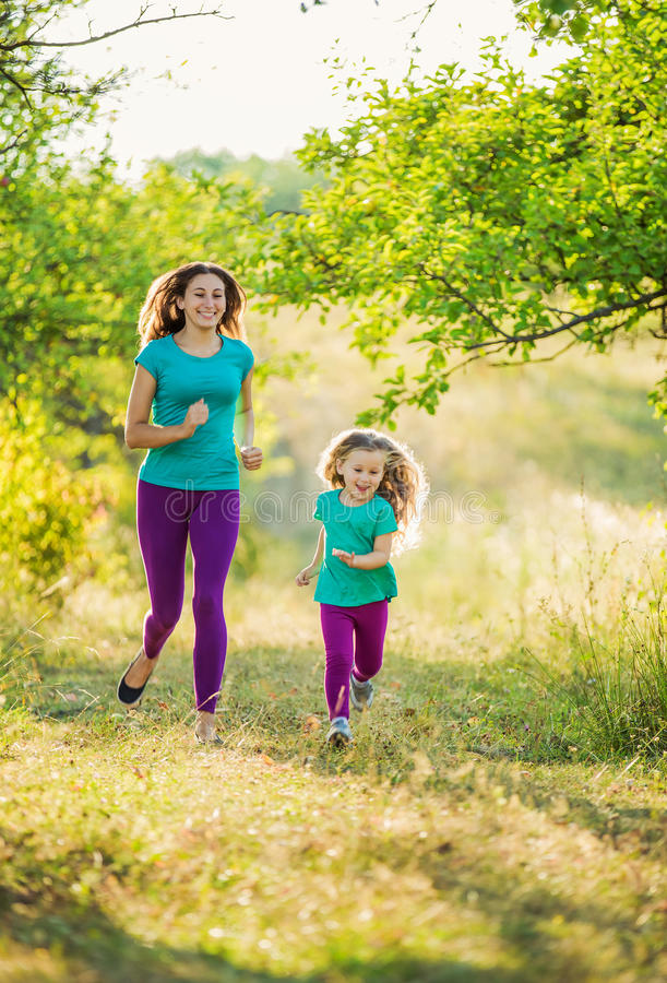 Mother with child running stock photo