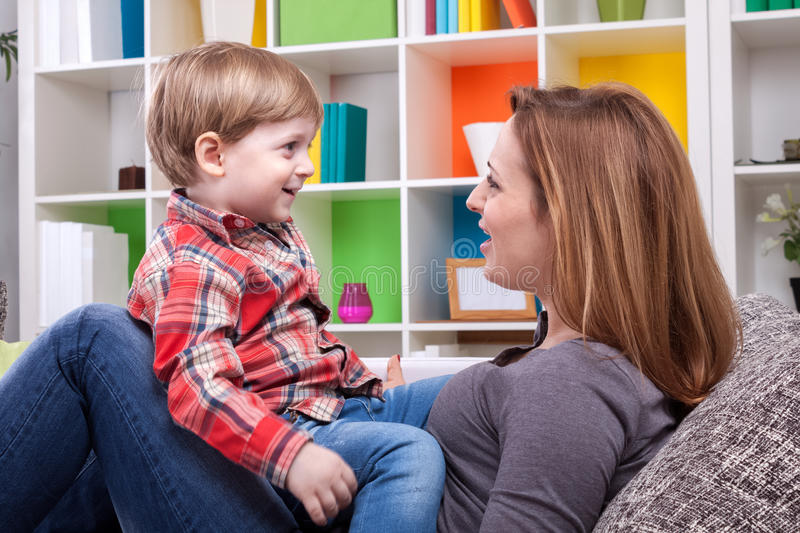Mother and child singing a song stock images