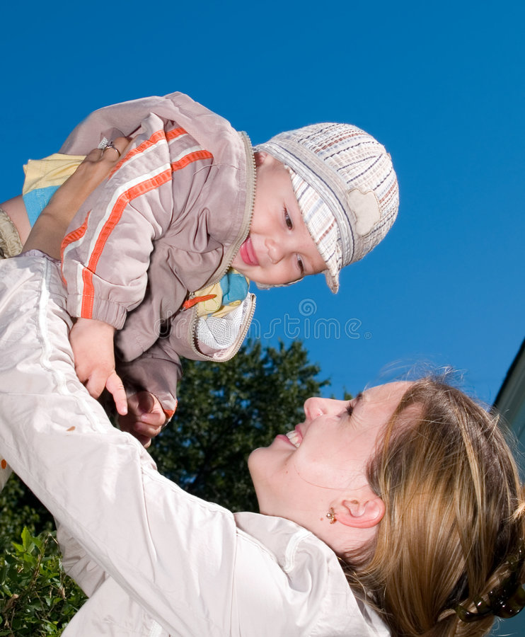 mother with child in the sky stock photography