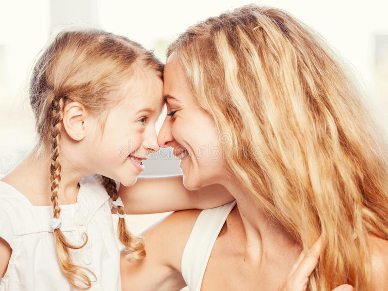 Mother with child smiling royalty free stock images