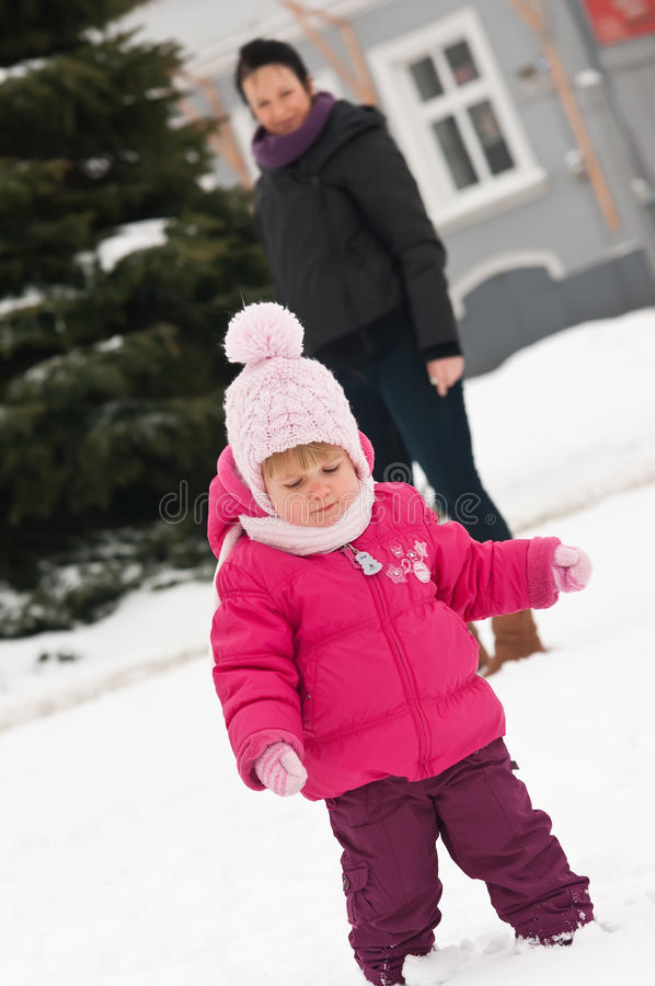 Download Mother and child in snow stock image. Image of watch - 23338175