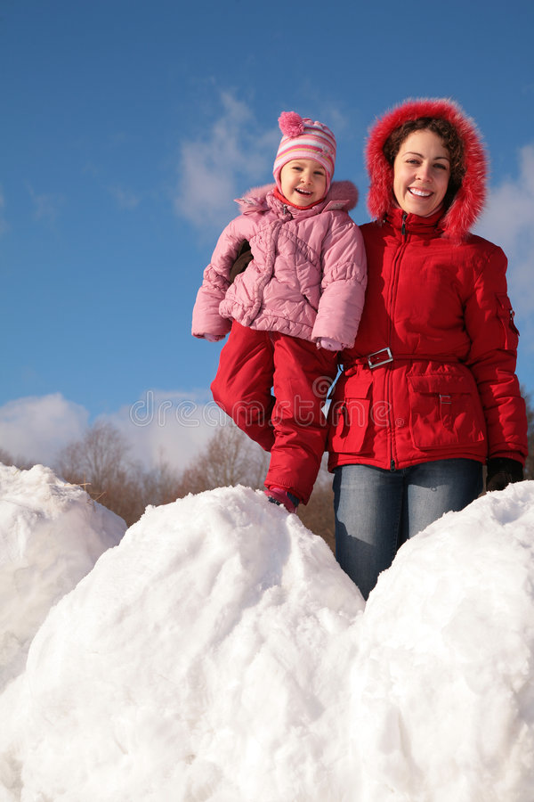 Mother and child on snowdrift stock photography