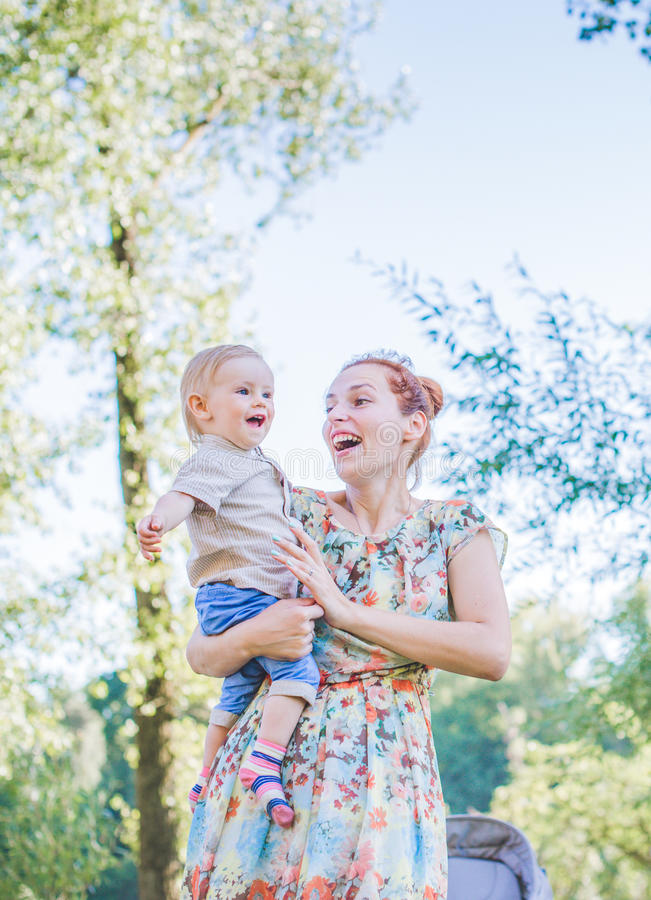 Mother and child in soap blowers. The are happy and joy. boy smiling and laughing. Summer day in park. royalty free stock photos