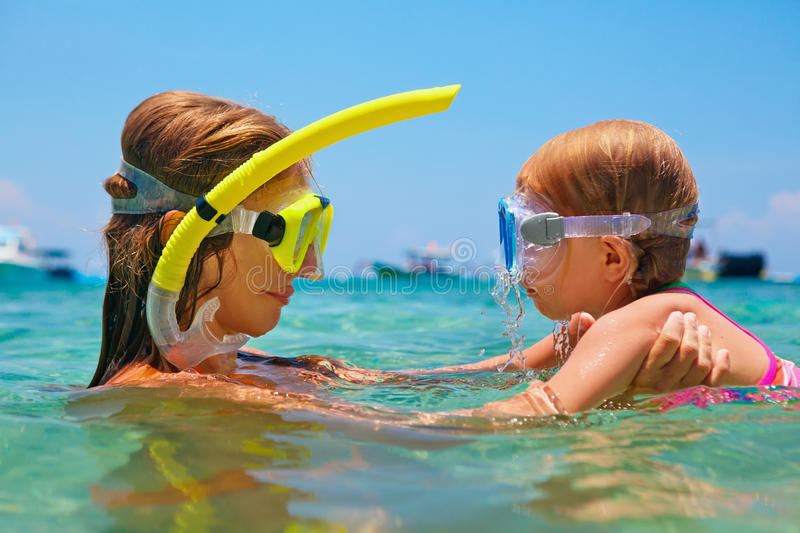Mother with child swim underwater with fun in sea. Happy family - mother with baby girl dive underwater with fun in sea pool. Healthy lifestyle, active parent royalty free stock images