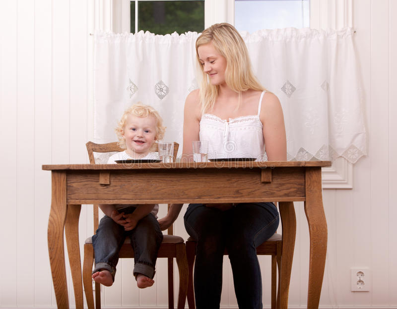 Mother and Child at Table royalty free stock photos