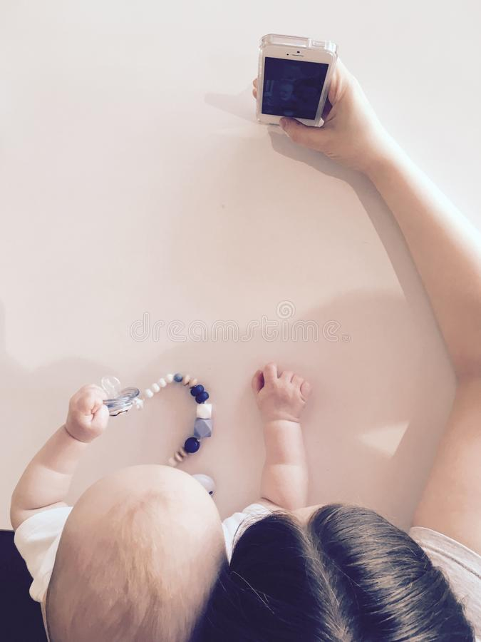 Mother with child are taking selfies royalty free stock photo