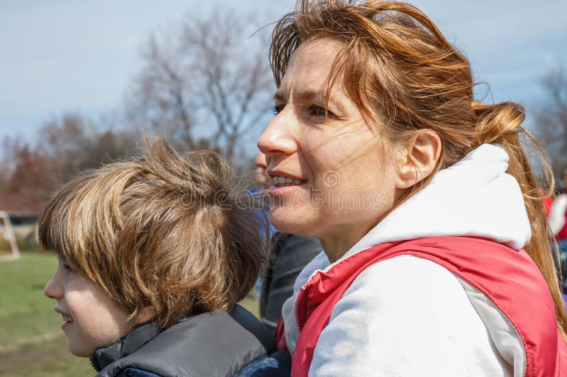 Mother and a child watching a game stock image