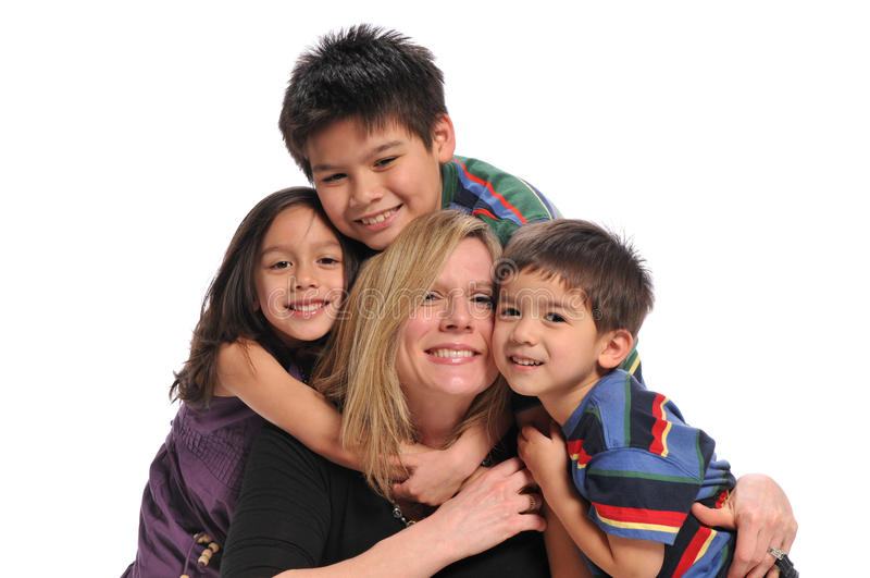 Mother and children. Mother and biracial children having fun isolated on a white background royalty free stock images