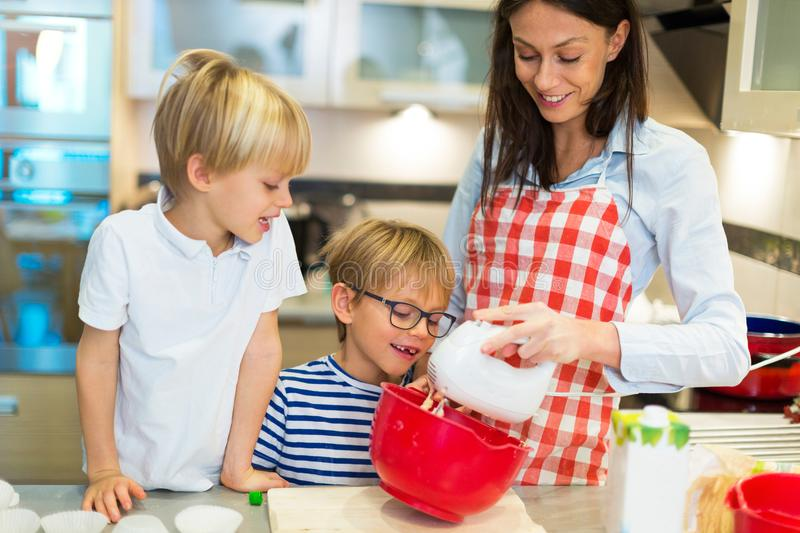 Mother and children baking together stock photography