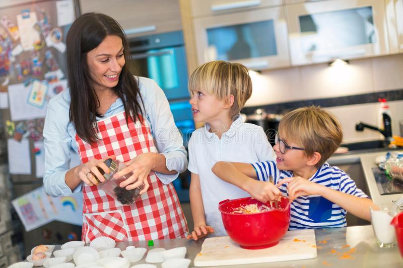 Mother and children baking together royalty free stock photos