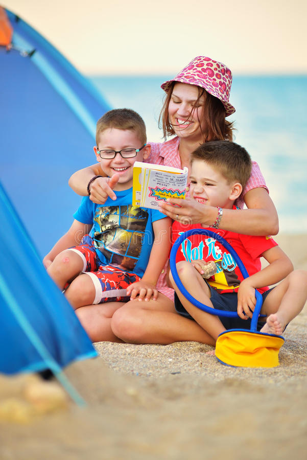 Mother and children camping and having fun on beach. Mother and children camping having fun on beach stock photos