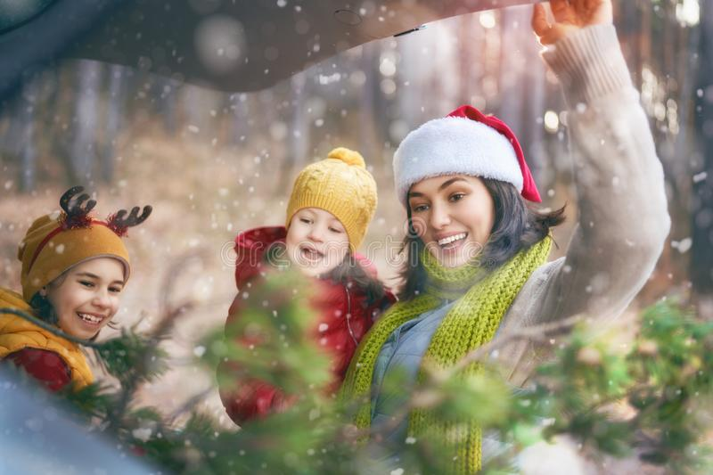 Mother, children and car on snowy winter nature stock photos