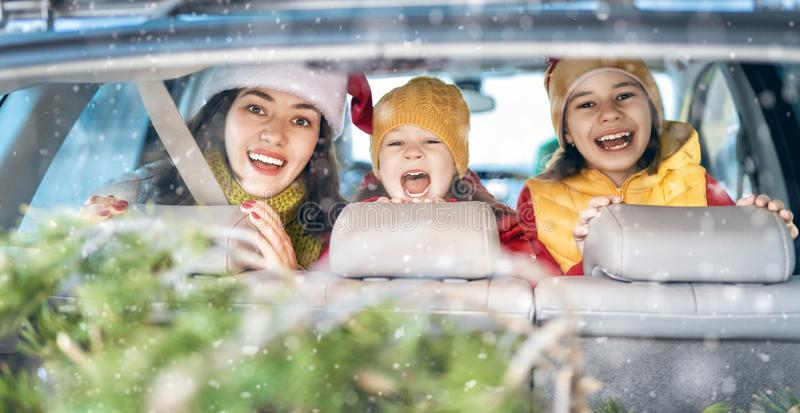 Mother, children and car on snowy winter nature stock photography