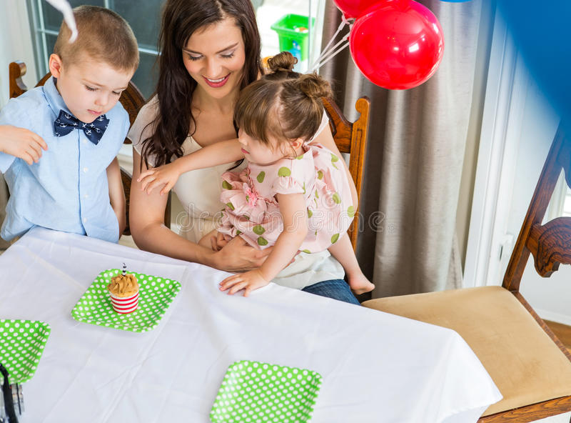 Mother And Children Celebrating Birthday Party stock photos