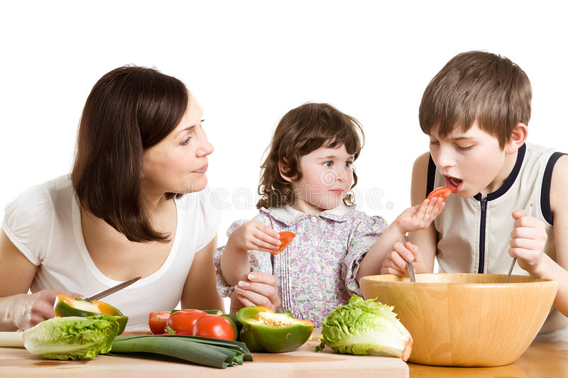 Mother and children cooking at the kitchen royalty free stock photos