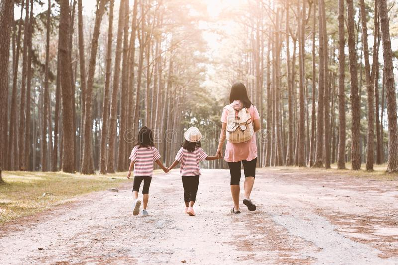 Mother and children daughter holding hand and walking together royalty free stock image