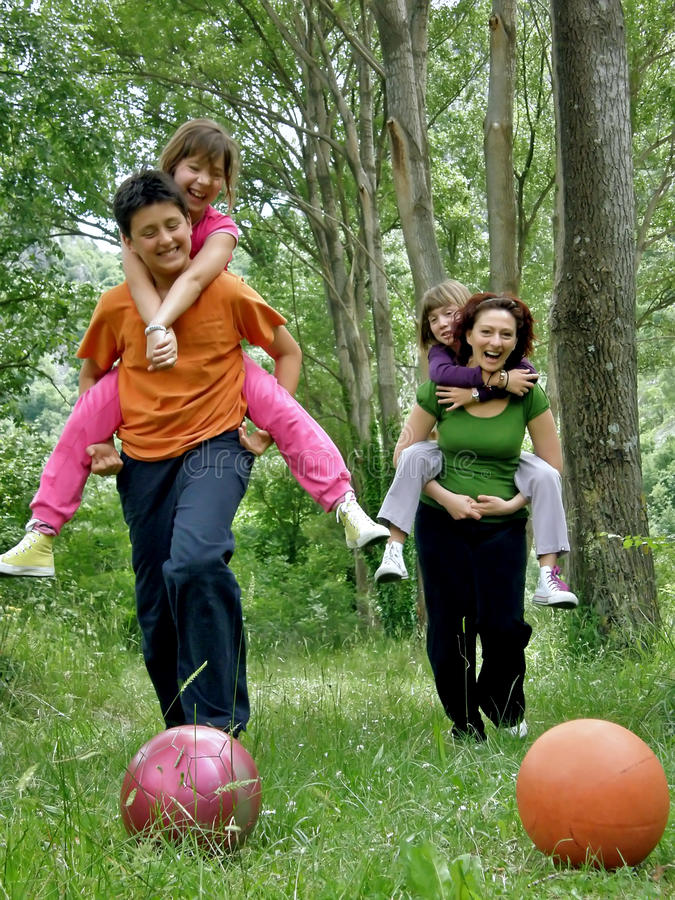 Download Mother and children in fun stock photo. Image of ball - 15087866
