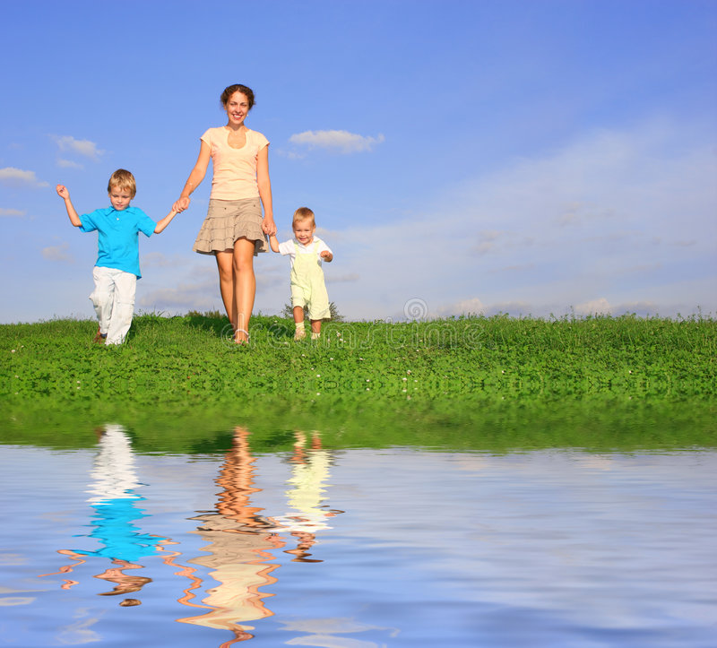 Download Mother With Children On Meadow Stock Photo - Image: 4501800