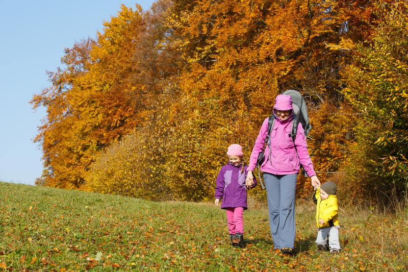 Mother with children hiking on a nice autumn day royalty free stock image